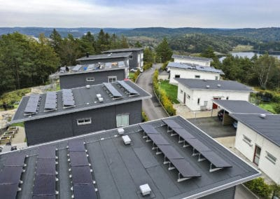 Photovoltaic solar panels cover the roofs of Swedish individual houses