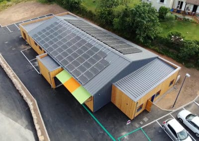 Nos fixations photovoltaïques sur la toiture d'un magasin de produits biologiques et équitables