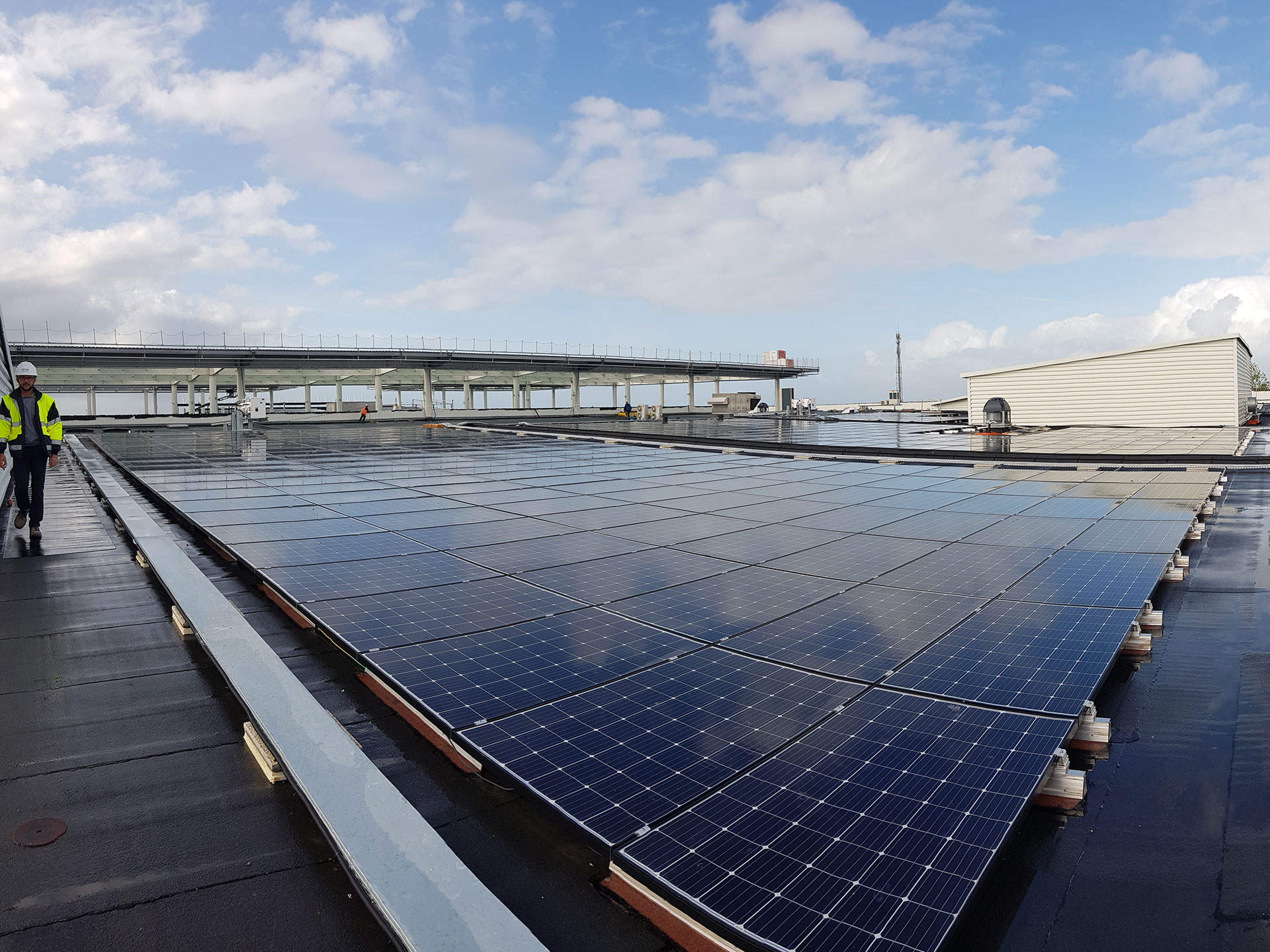 Photovoltaic-modules-bitumen-flat-roof-shopping center